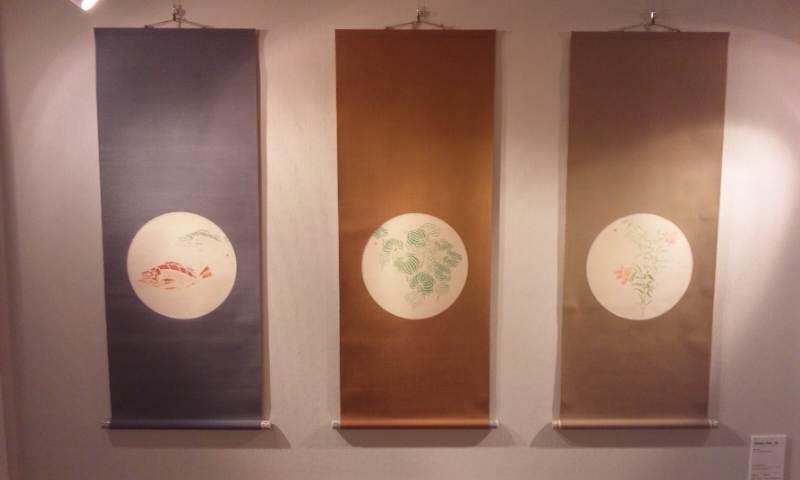 three hanging scrolls